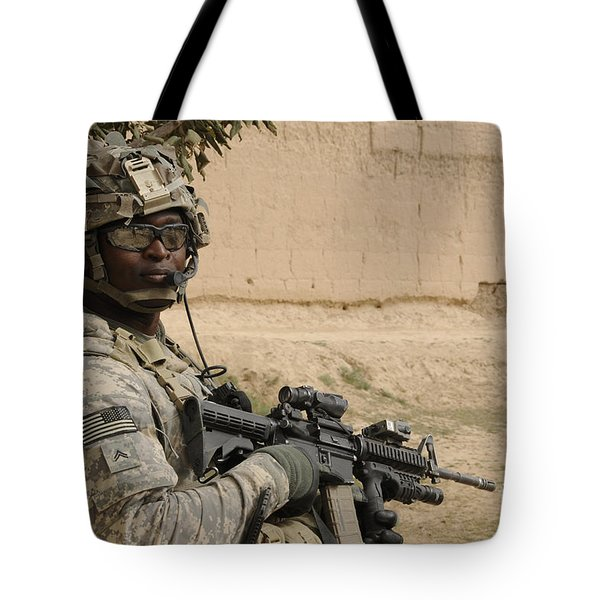 U.s. Army Soldier Scans His Area While Tote Bag by Stocktrek Images