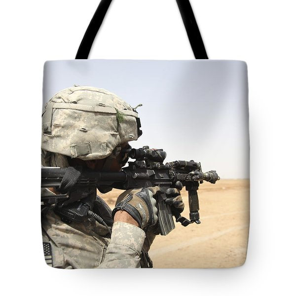 U.s. Army Soldier Scans The Horizon Tote Bag by Stocktrek Images