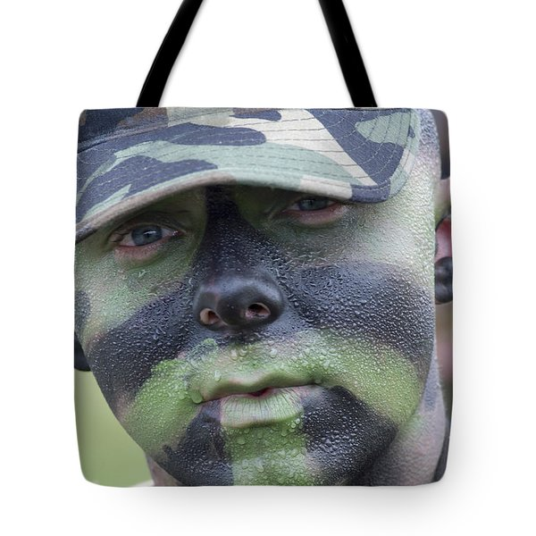 U.s. Army Soldier Wearing Camouflage Tote Bag by Stocktrek Images