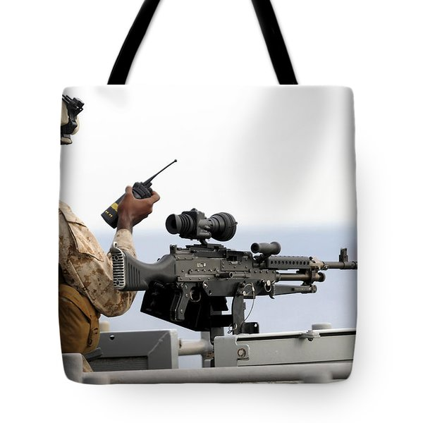 U.s. Marine Talks On A Radio While Tote Bag by Stocktrek Images