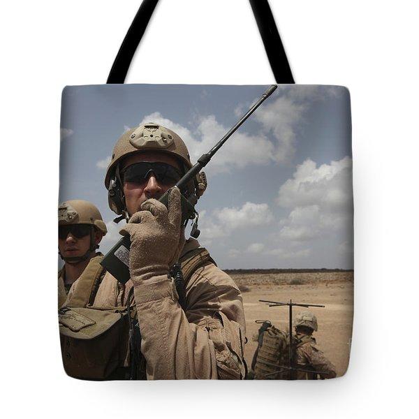 U.s. Marine Uses A Radio In Djibouti Tote Bag by Stocktrek Images