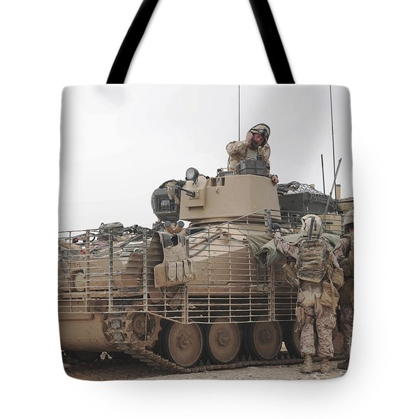 U.s. Marines Talk With A British Tote Bag by Stocktrek Images