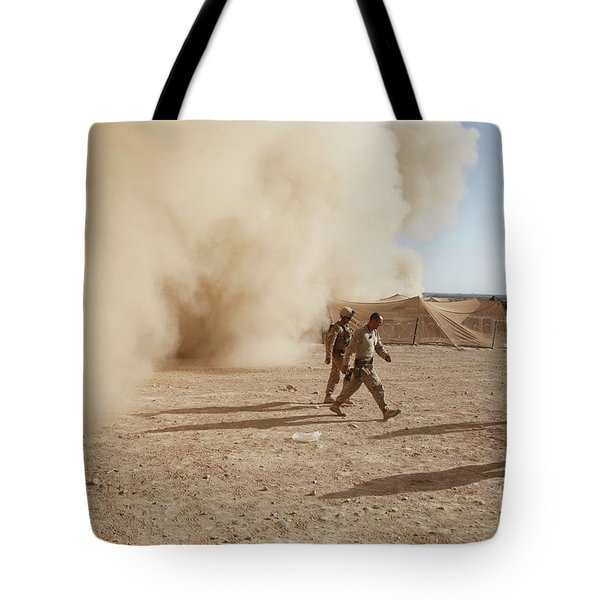 U.s. Marines Walk Away From A Dust Tote Bag by Stocktrek Images