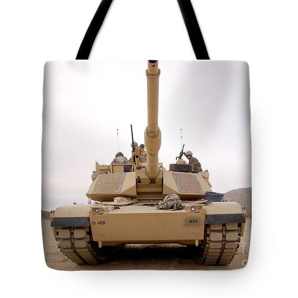 U.s. Soldiers Perform Maintenance Tote Bag by Stocktrek Images