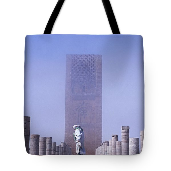 Veiled Woman Walking Infront Of Hassan Tote Bag by Axiom Photographic