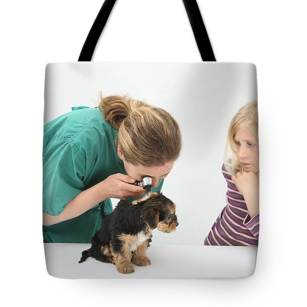 Vet Using An Otoscope To Examine A Pups Tote Bag by Mark Taylor