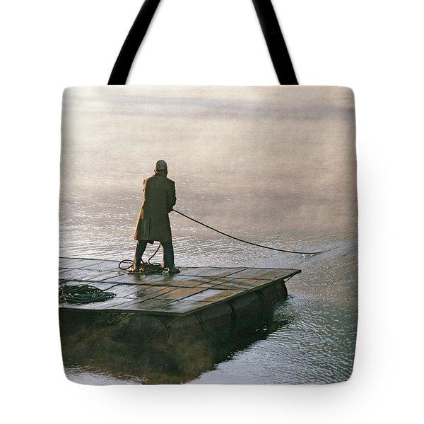 Villager On Raft Crosses Lake Phewa Tal Tote Bag by Gordon Wiltsie