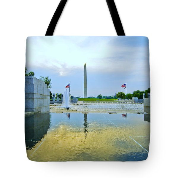 Tote Bag featuring the photograph Washington Monument And The World War II Memorial by Jim Moore