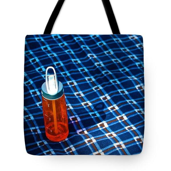 Water Bottle On A Blanket Tote Bag by Eric Tressler