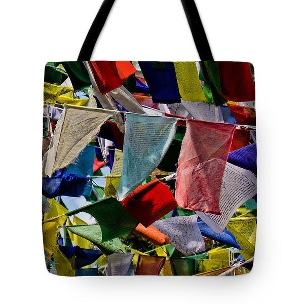 Tote Bag featuring the photograph Waving Prayer Flags by Don Schwartz