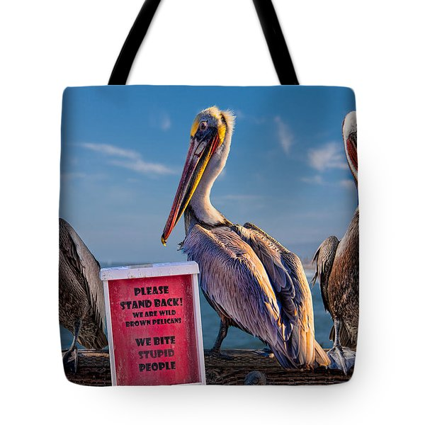 We Bite Stupid People Tote Bag by Chris Lord