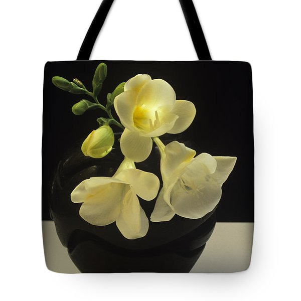 Tote Bag featuring the photograph White Freesias In Black Vase by Susan Rovira