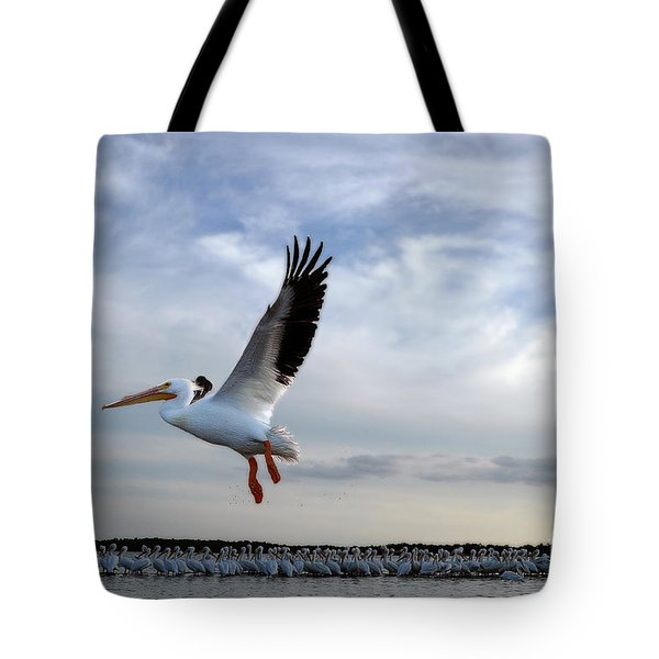 Tote Bag featuring the photograph White Pelican Flying Over Island by Dan Friend