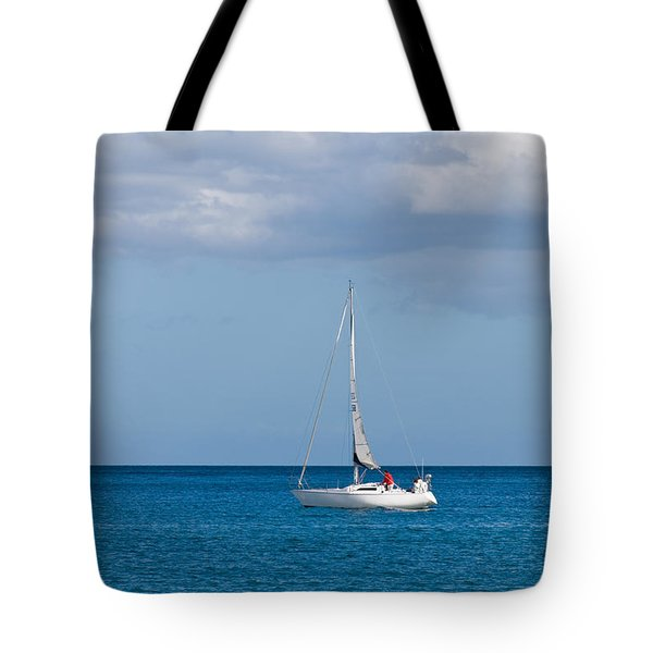White Yacht Sails In The Sea Along The Coast Line Tote Bag by Ulrich Schade