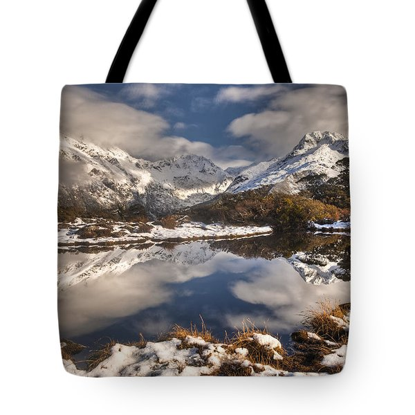 Winter Dawn Reflection Of Mount Tote Bag by Colin Monteath