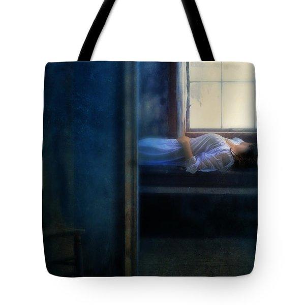 Woman In Nightgown In Bed By Window Tote Bag by Jill Battaglia