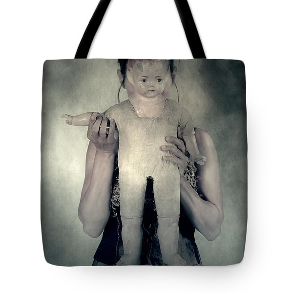 Woman With Doll Tote Bag by Joana Kruse