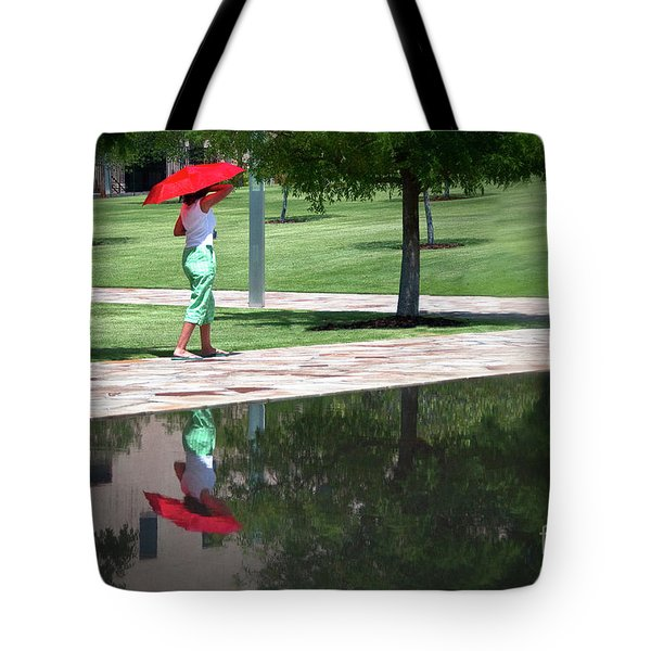 Woman With The Red Umbrella Tote Bag by Tamyra Ayles