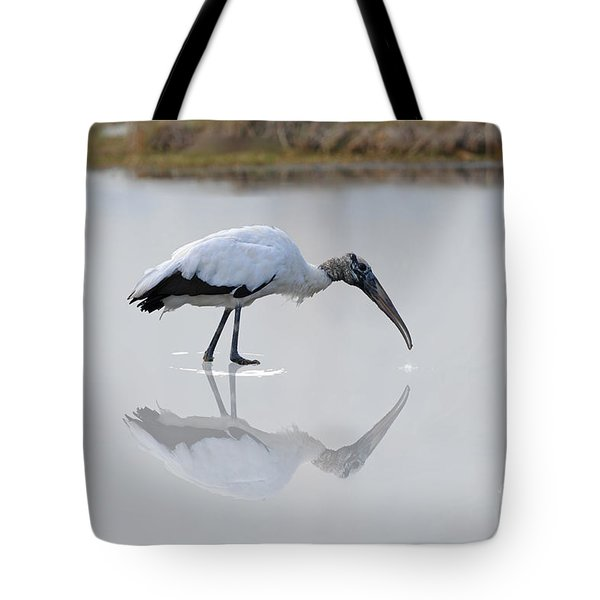 Tote Bag featuring the photograph Wood Stork Eating by Dan Friend