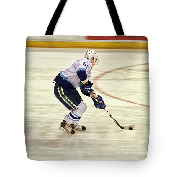 Working The Puck Tote Bag by Karol Livote