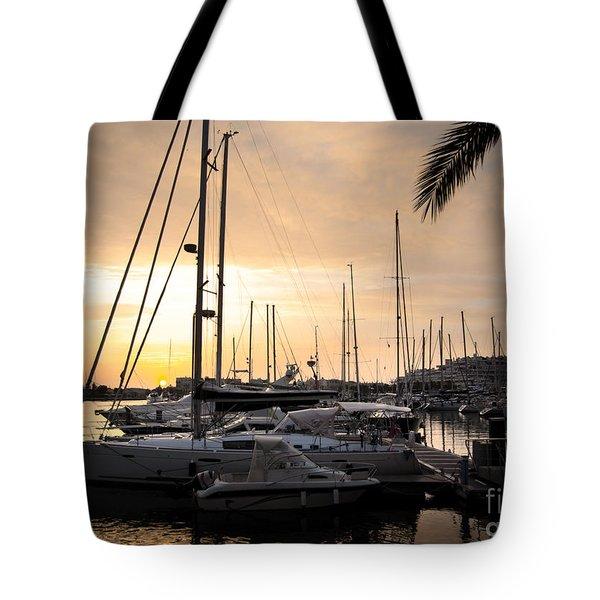 Yachts At Sunset Tote Bag by Carlos Caetano