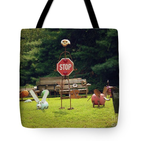 Tote Bag featuring the photograph Yard Art Stop by Renee Trenholm
