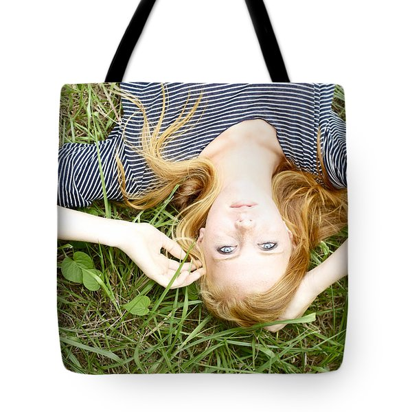 Young Girl On Grass Tote Bag by Kicka Witte