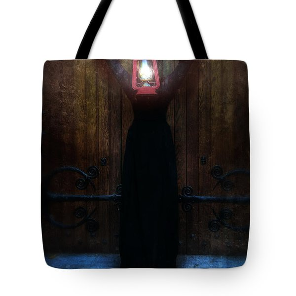 Young Woman In Black Lantern In Front Of Her Face Tote Bag by Jill Battaglia
