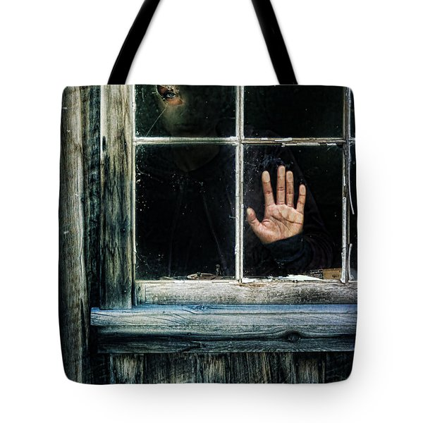 Young Woman Looking Through Hole In Window Tote Bag by Jill Battaglia