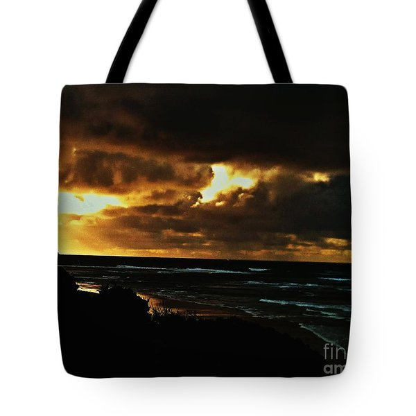 A Stormy Sunrise Tote Bag