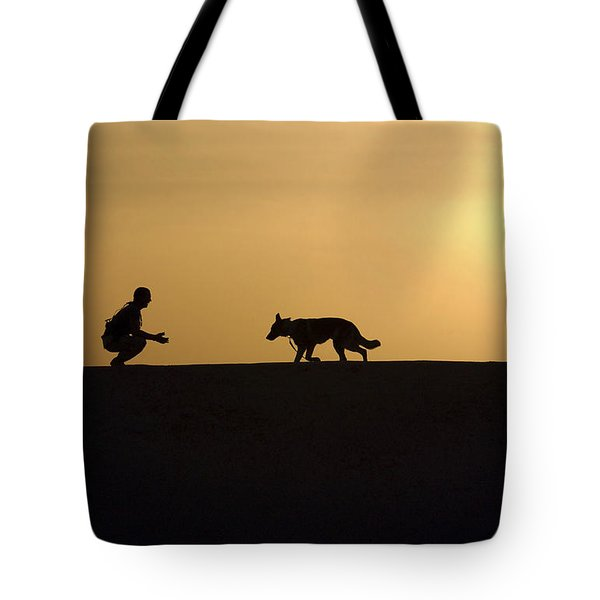 A Military Working Dog And His Handler Tote Bag by Stocktrek Images