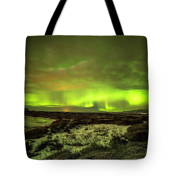Aurora Borealis Over A Frozen Lake Tote Bag by Joe Belanger
