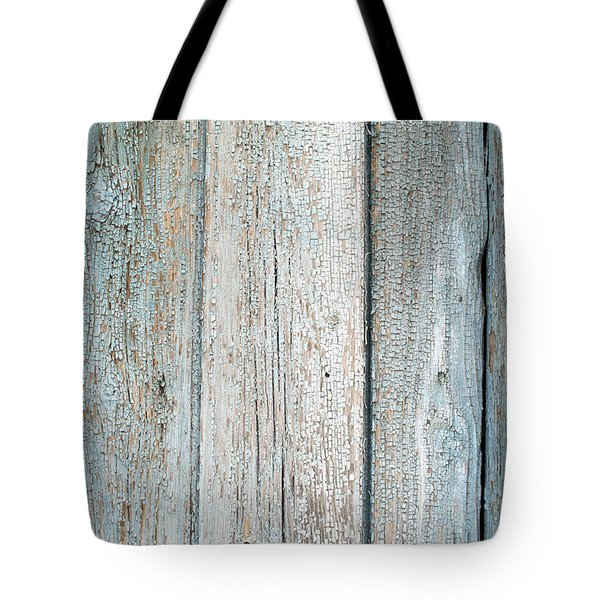Tote Bag featuring the photograph Blue Fading Paint On Wood by John Williams