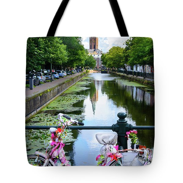 Tote Bag featuring the digital art Canal And Decorated Bike In The Hague by RicardMN Photography
