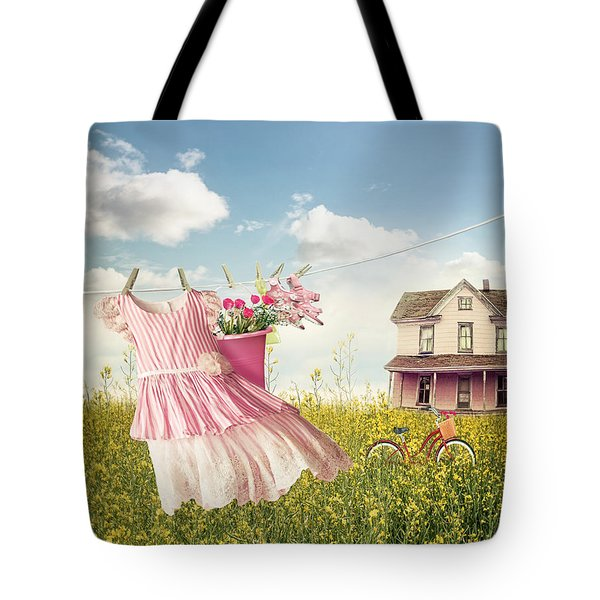 Child's Dress And Toys Hanging On Line With Farmhouse In Backgro Tote Bag
