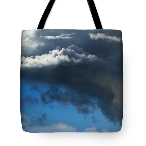 Cows Grazing Under Dramatic Clouds Tote Bag by Wernher Krutein