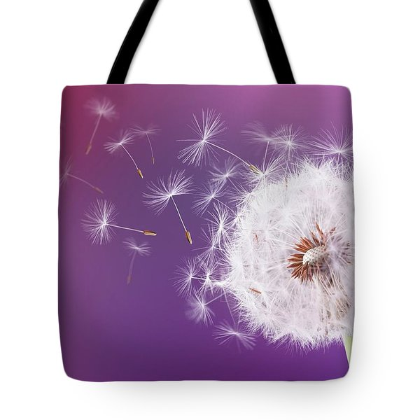 Dandelion Flying On Magenta Background Tote Bag