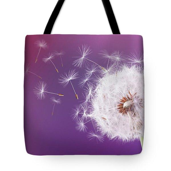 Dandelion Flying On Magenta Background Tote Bag