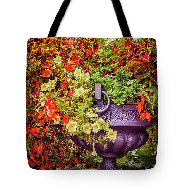 Tote Bag featuring the photograph Decorative Flower Vase In Garden by Ariadna De Raadt