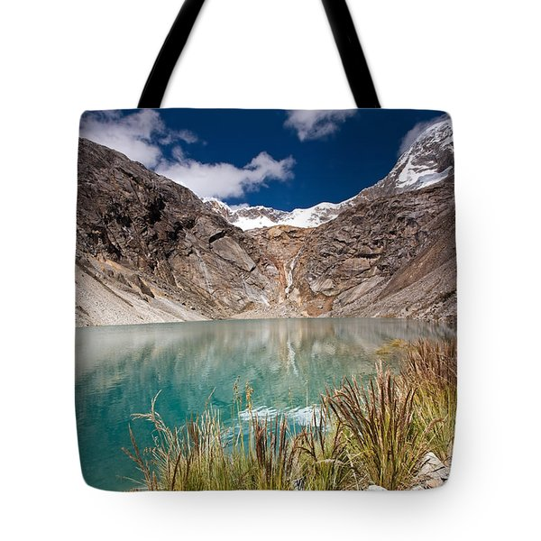 Emerald Green Mountain Lake At 4500m Tote Bag by Aivar Mikko