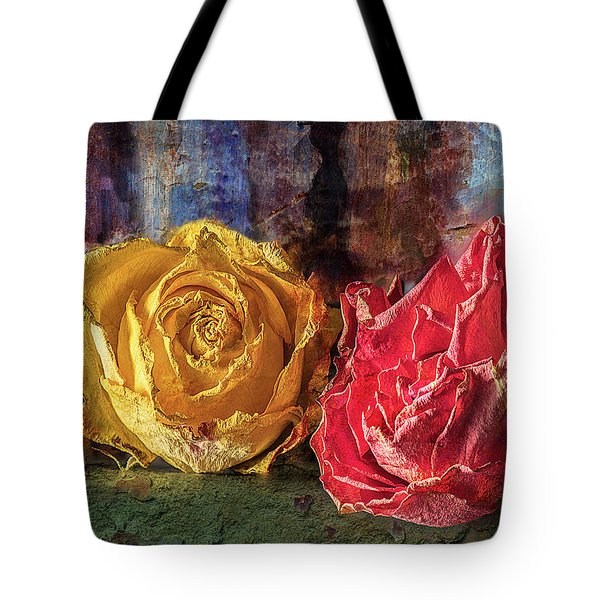 Tote Bag featuring the photograph Faded Flowers by Vladimir Kholostykh