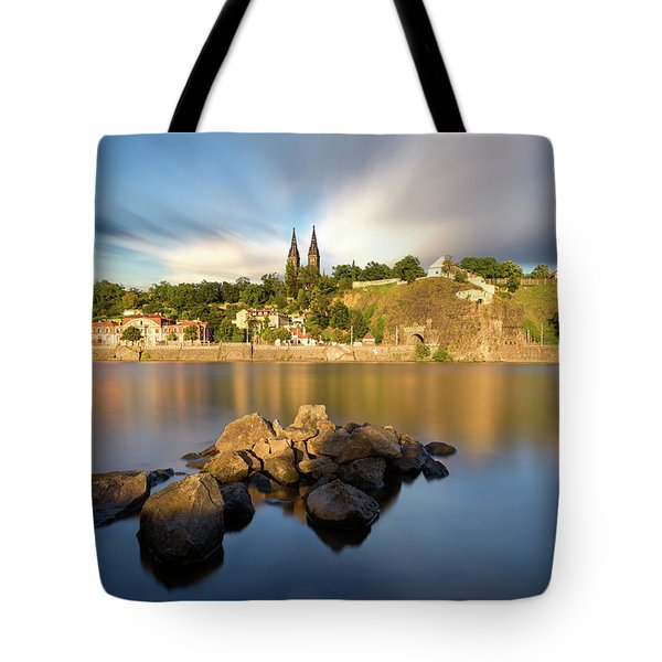 Famous Vysehrad Church During Sunny Day. Amazing Cloudy Sky In Motion. Vltava River, Prague, Czech Republic Tote Bag