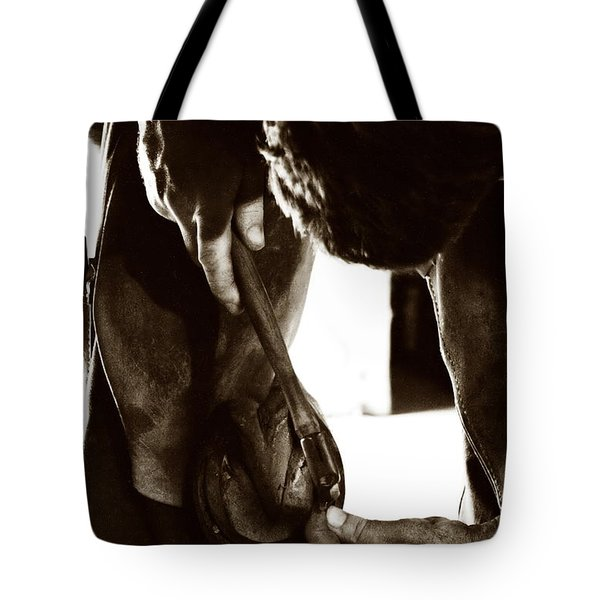 Tote Bag featuring the photograph Farrier At Work by Angela Rath