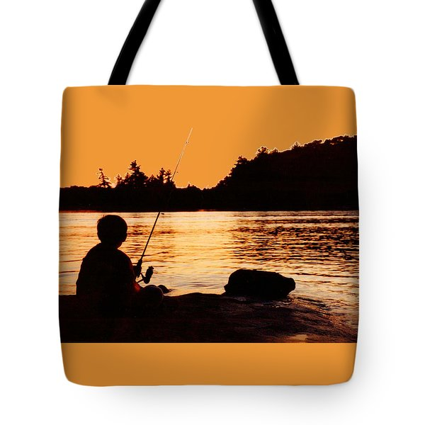 Fishing From A Rock  Tote Bag by Lyle Crump