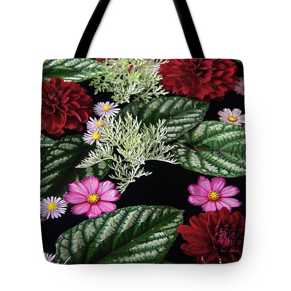 Tote Bag featuring the photograph Floating Flower Bouquet by Byron Varvarigos