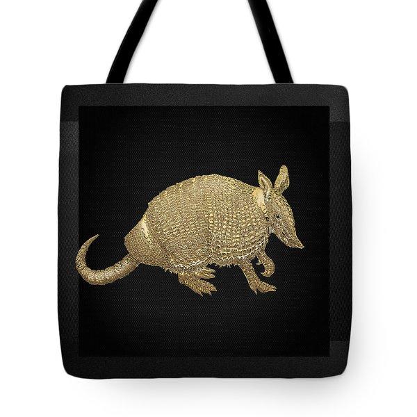 Gold Armadillo On Black Canvas Tote Bag