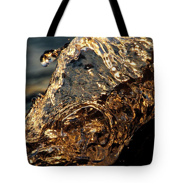 Tote Bag featuring the photograph Golden Wave by Rico Besserdich
