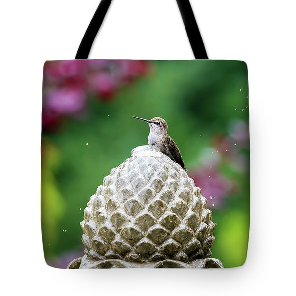 Hummingbird On Garden Water Fountain Tote Bag by David Gn