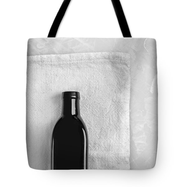 Tote Bag featuring the photograph Little Black Bottle  by Andrey  Godyaykin