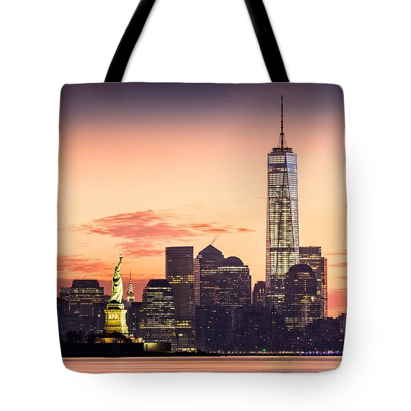Tote Bag featuring the photograph Lower Manhattan And The Statue Of Liberty At Sunrise by Mihai Andritoiu